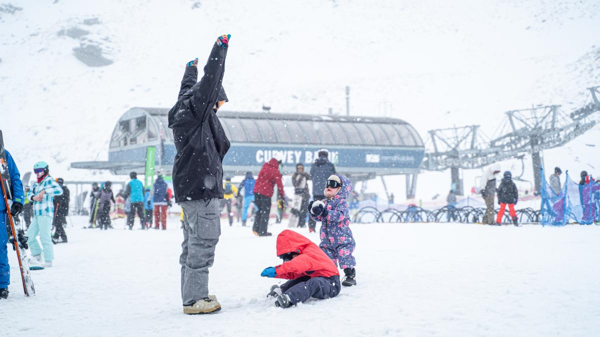 Family having fun in the snow at The Remarkables