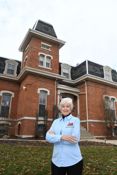 Deanna Hindsley in front of the Hendricks County Historical Museum
