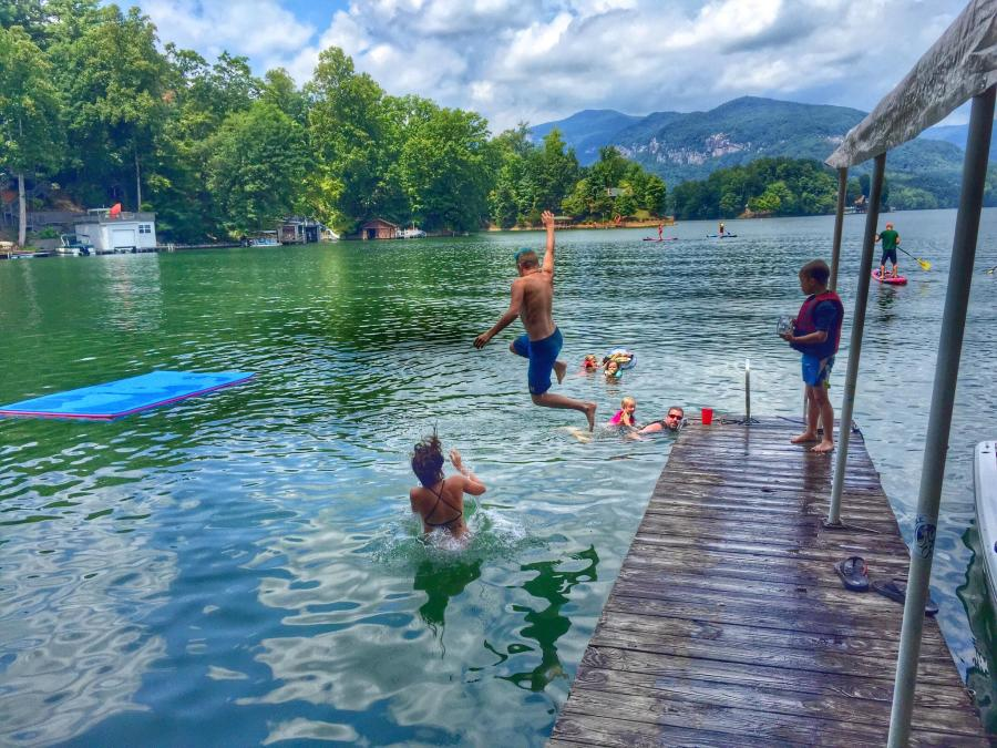 A group of friends jumping into Lake Lure, NC