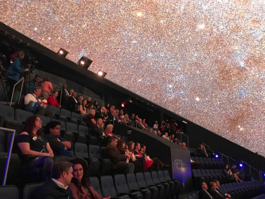 Visitors enjoy an engaging program at the Intuitive Planetarium in Huntsville.