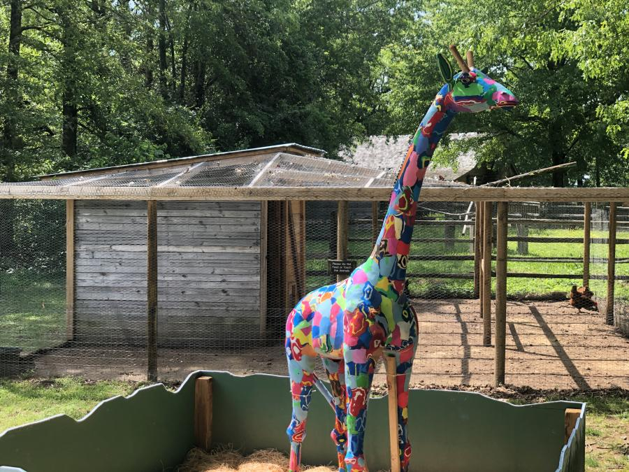 A multi-colored giraffe on display at Burritt on the Ocean Sole Africa in Huntsville, AL