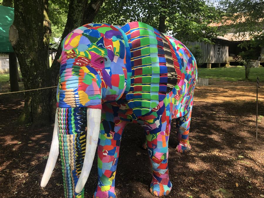 A brightly colored elephant sculpture on display at Burritt on the Mountain Whimsical Woods.