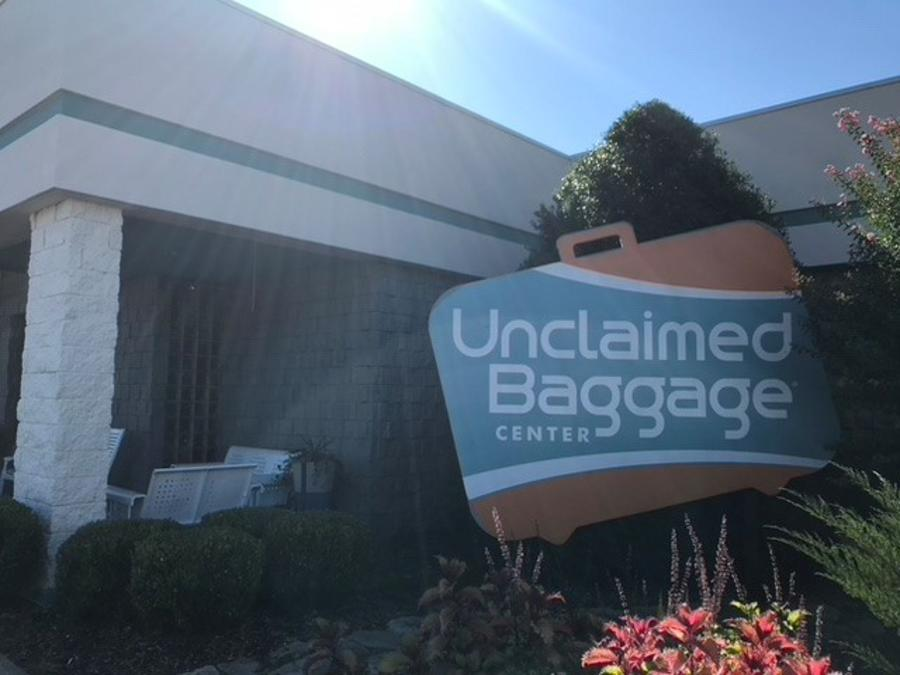 A sign welcomes guests to the main entrance of the Unclaimed Baggage Center in Scottsboro.