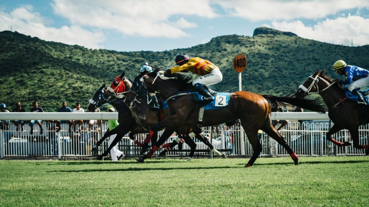 man riding horse in race