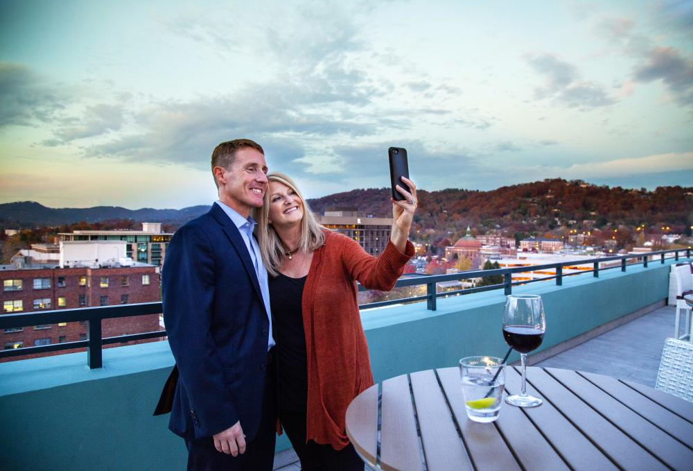 Couple Taking Selfie Photo from Rooftop Lounge in Downtown Asheville