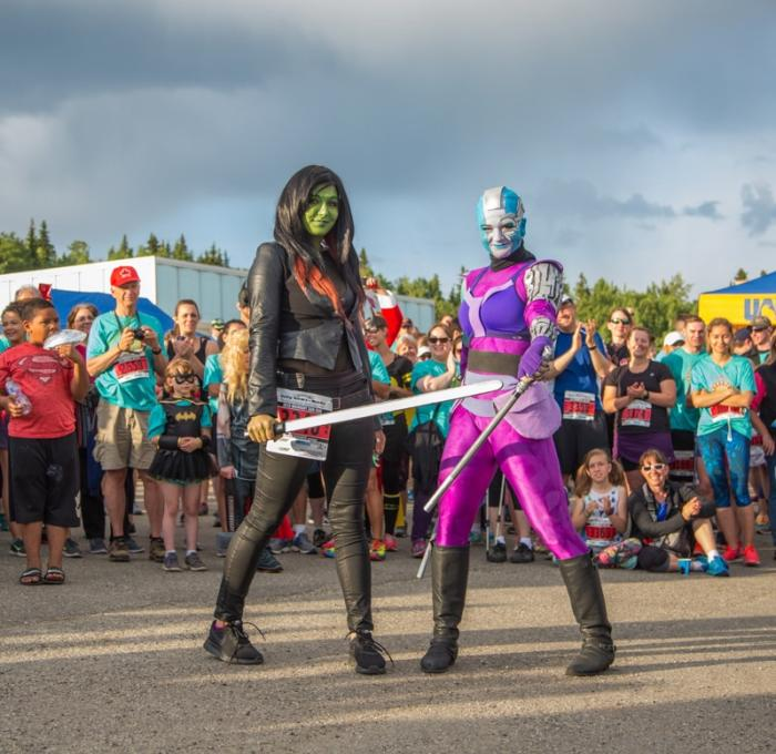 "two women at midnight sun run dressed as Nebula and Gamora from Marvel's ""Guardians of the Galaxy"""