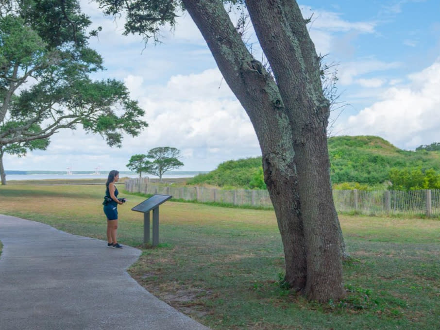 Woman Reading Plaque At Fort Fisher State Historic Site