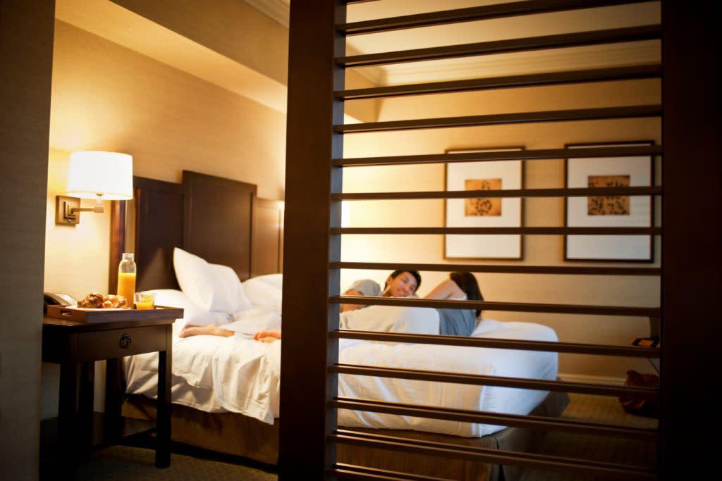 Hyatt Room Couple on Bed