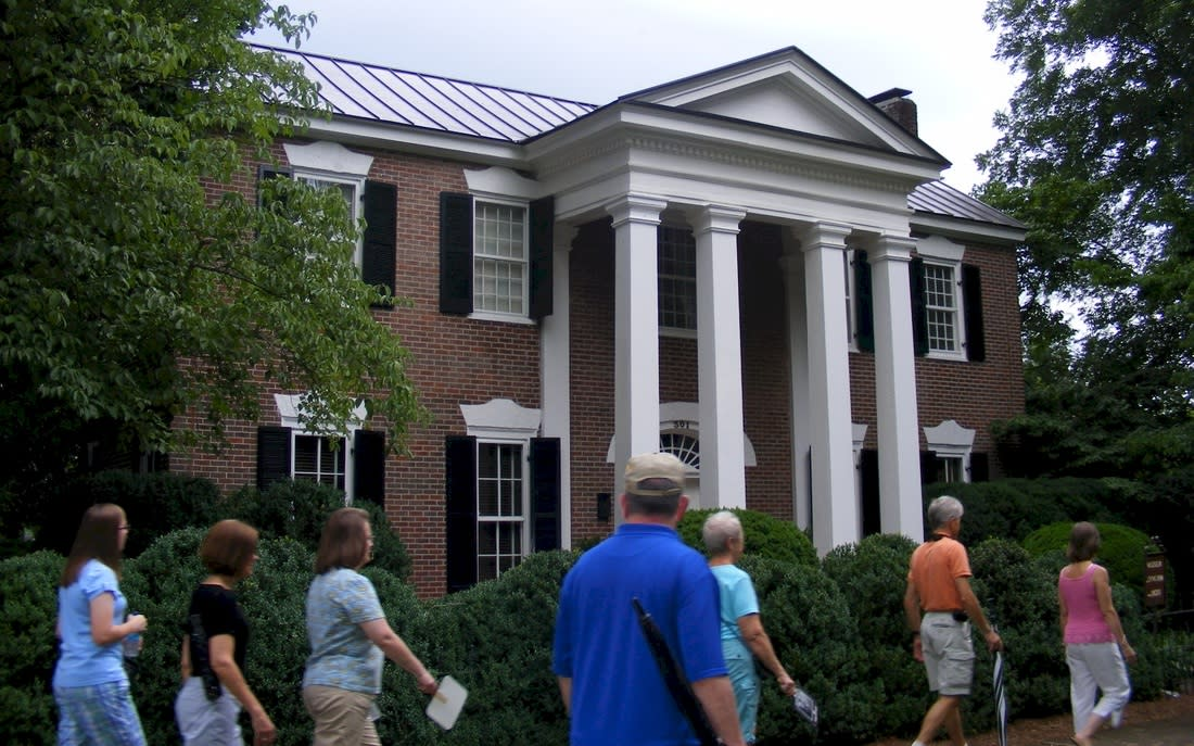 Exterior view of historic building in Athens, AL with walking tour in foreground