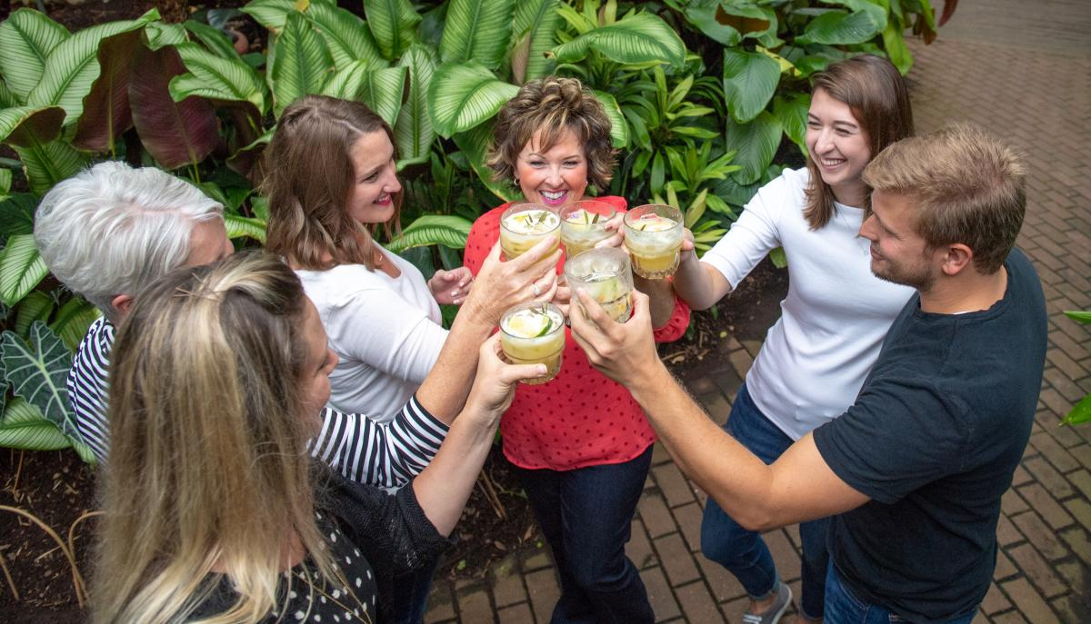 Totally Tropical attendees raise their glasses for a cheers
