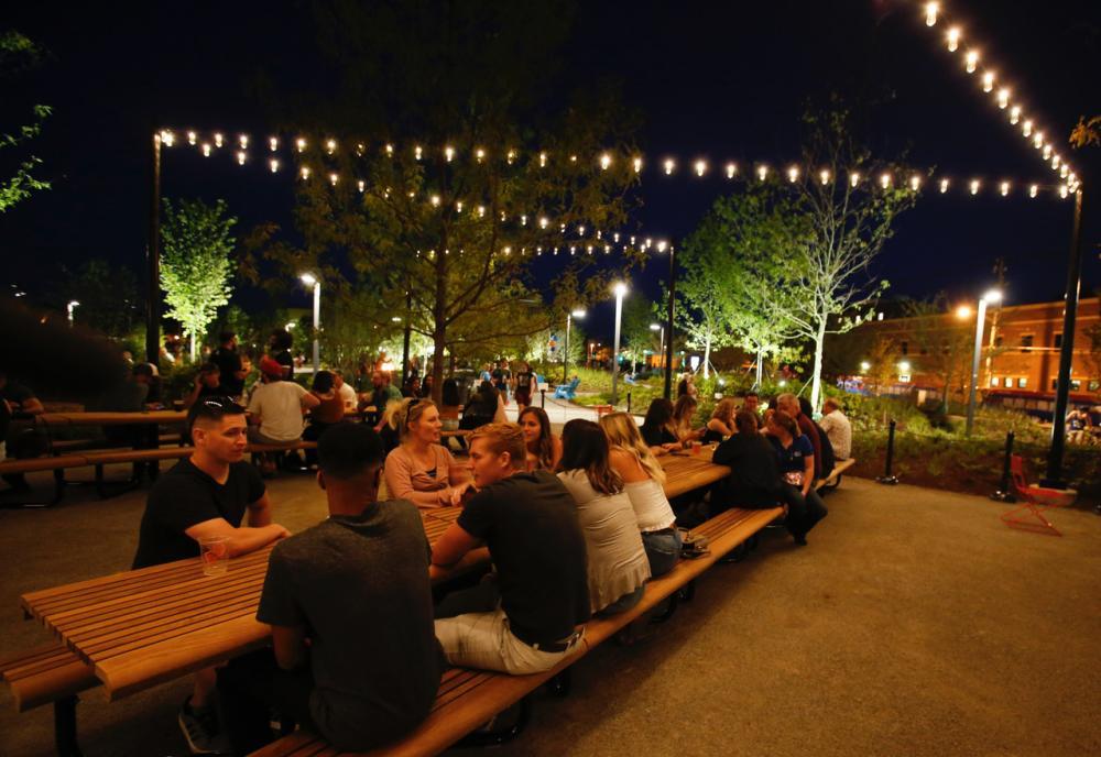 Promenade Park visitors enjoy the Journal Gazette Dining Gardens at Night