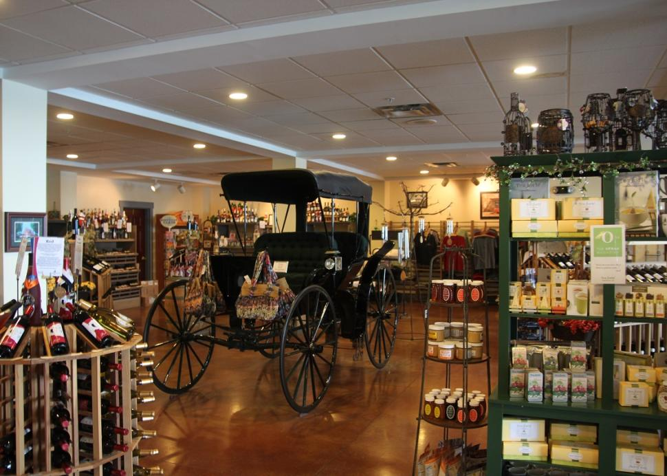 Photo of an old carrage inside the Belhurst Estate Winery
