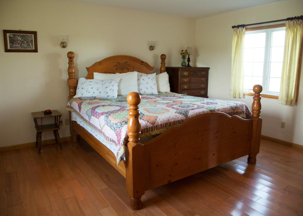Bed inside of the Cayuga Cottage's king room