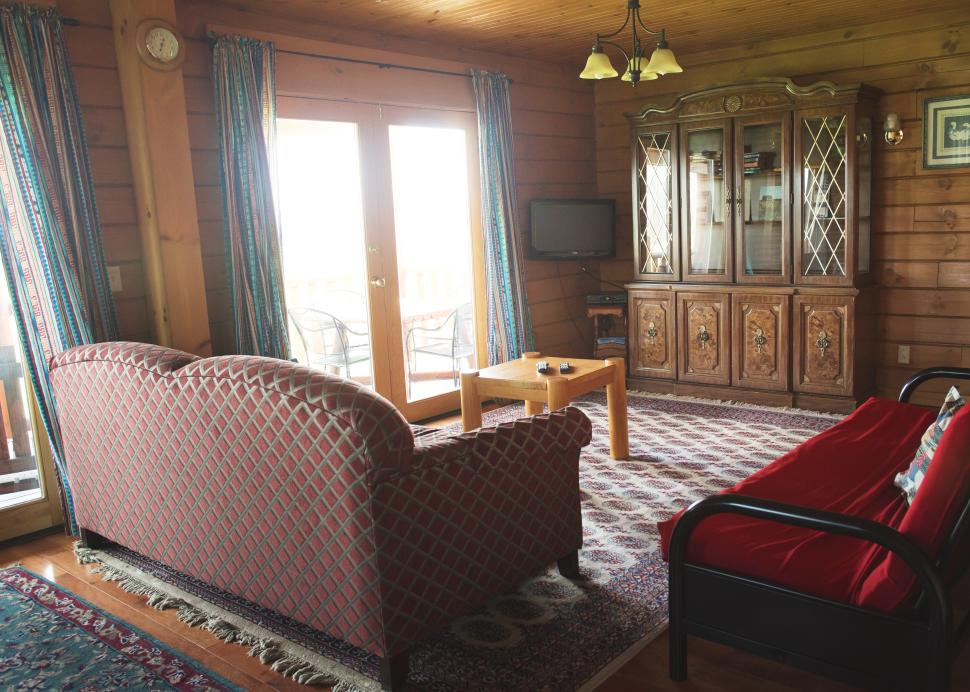 The living room inside of the Conesus Cabin