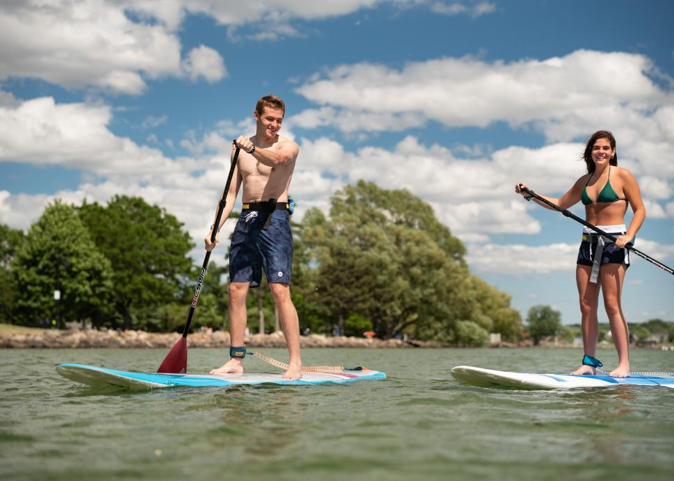 People stand up paddleboarding