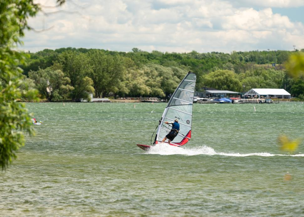 Person windsurfing on Canandaigua Lake