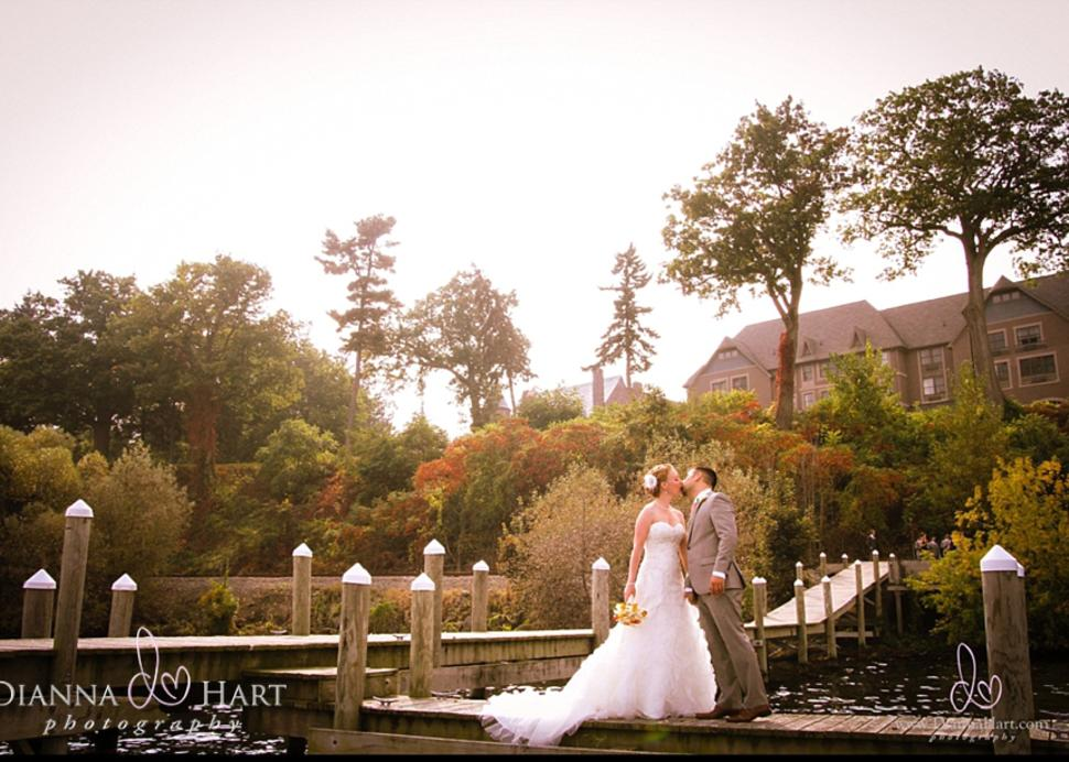 Bride and Groom on a dock at Belhurst Castle