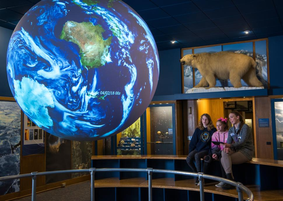 Family looking at earth exhibit at Rochester Museum & Science Center