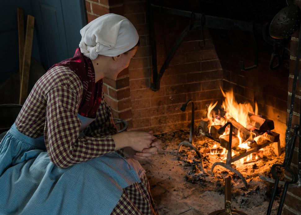 Woman cooking on fire at Genesee Country Village & Museum