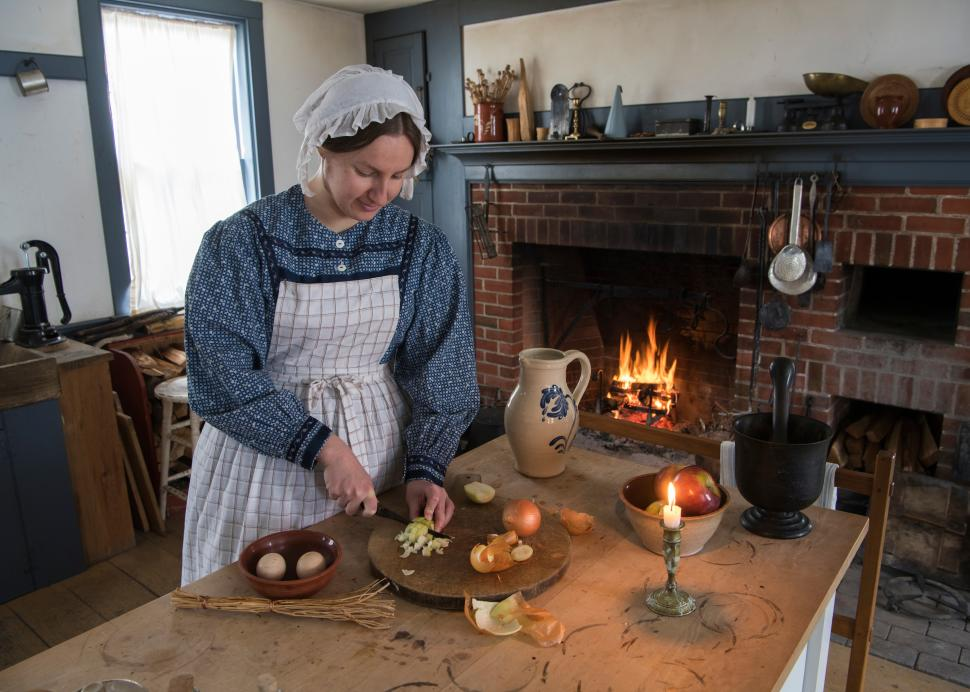 Woman in kitchen cooking at Genesee Country Village & Museum