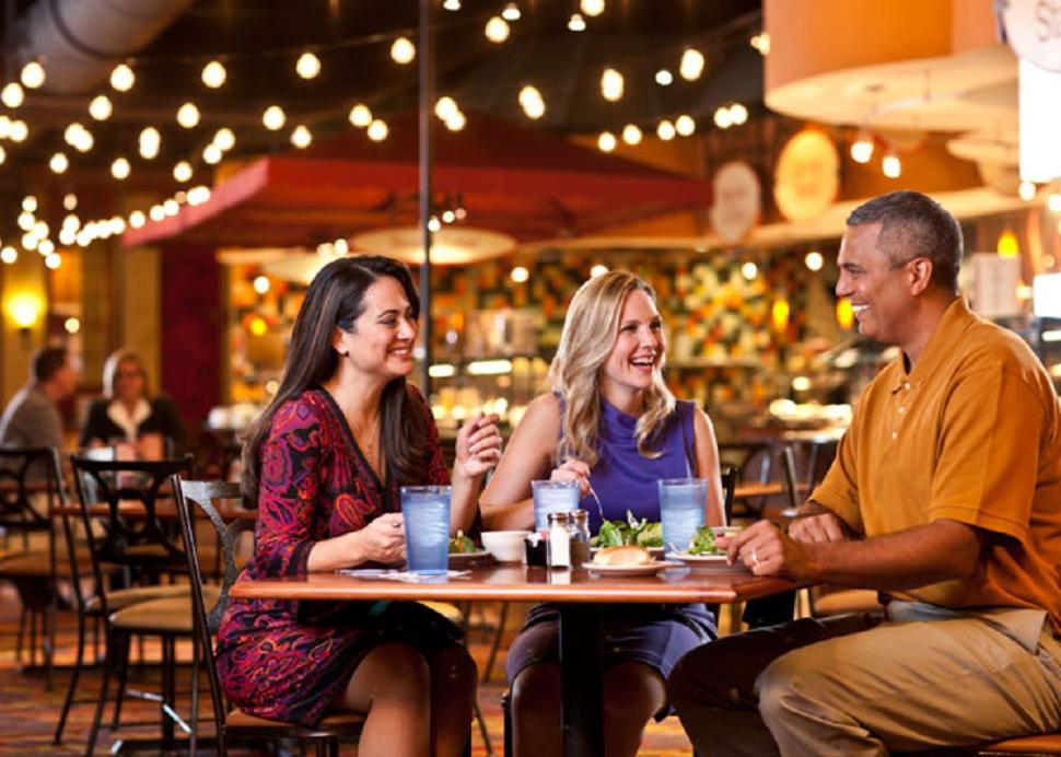 Photo of a Family smiling while dining in the Finger Lakes Gaming and Racetrack