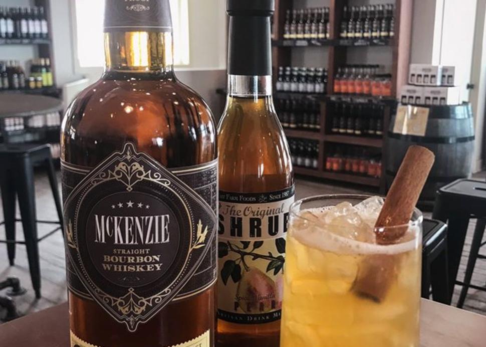 Finger_Lakes_Distilling_Bottle_with_Drink_inside_Tasting_Room