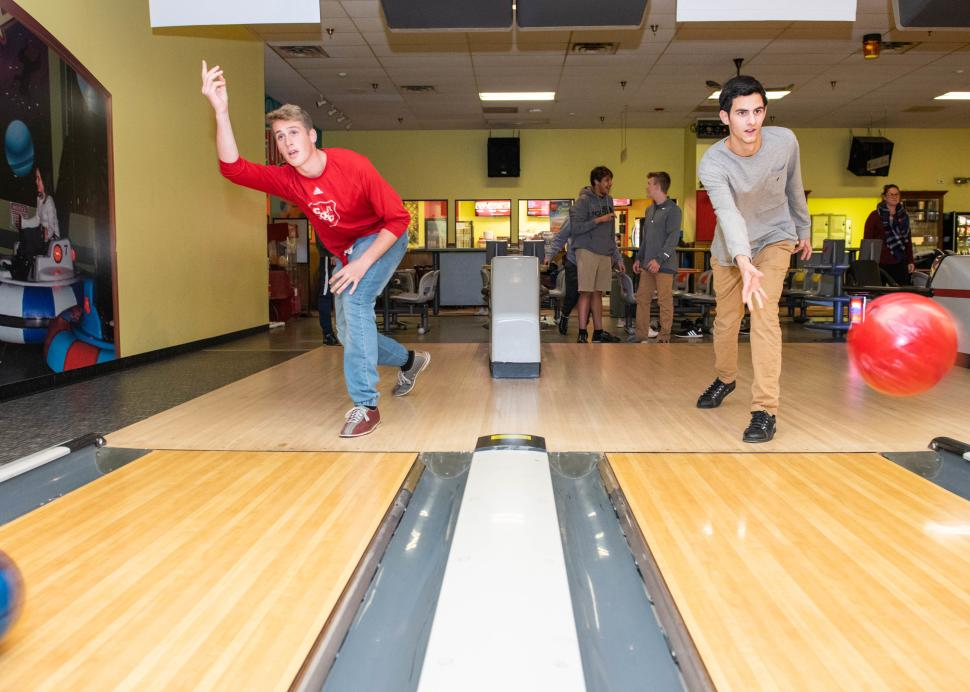 Two kids enjoy bowling at the Roseland Bowl Family Fun Center