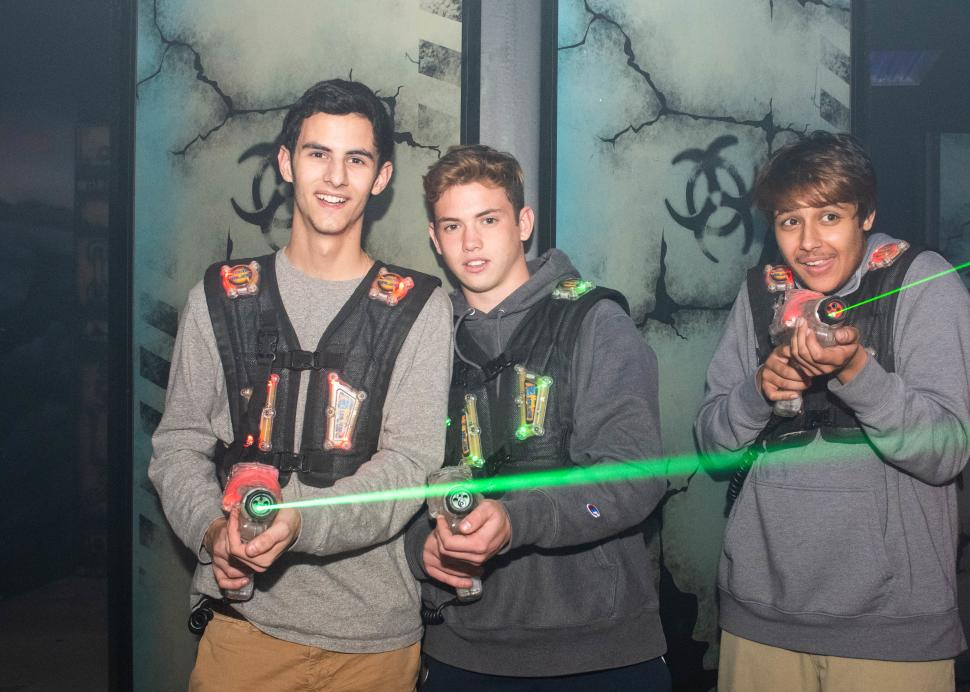 Three boys pose during a game of lazer tag inside of the Roseland Family Fun Center
