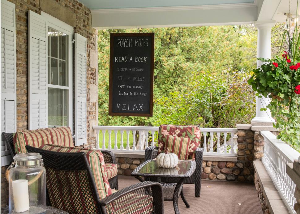 Photo Of An Outdoor Porch With Armchairs At The Cobblestone Cottage