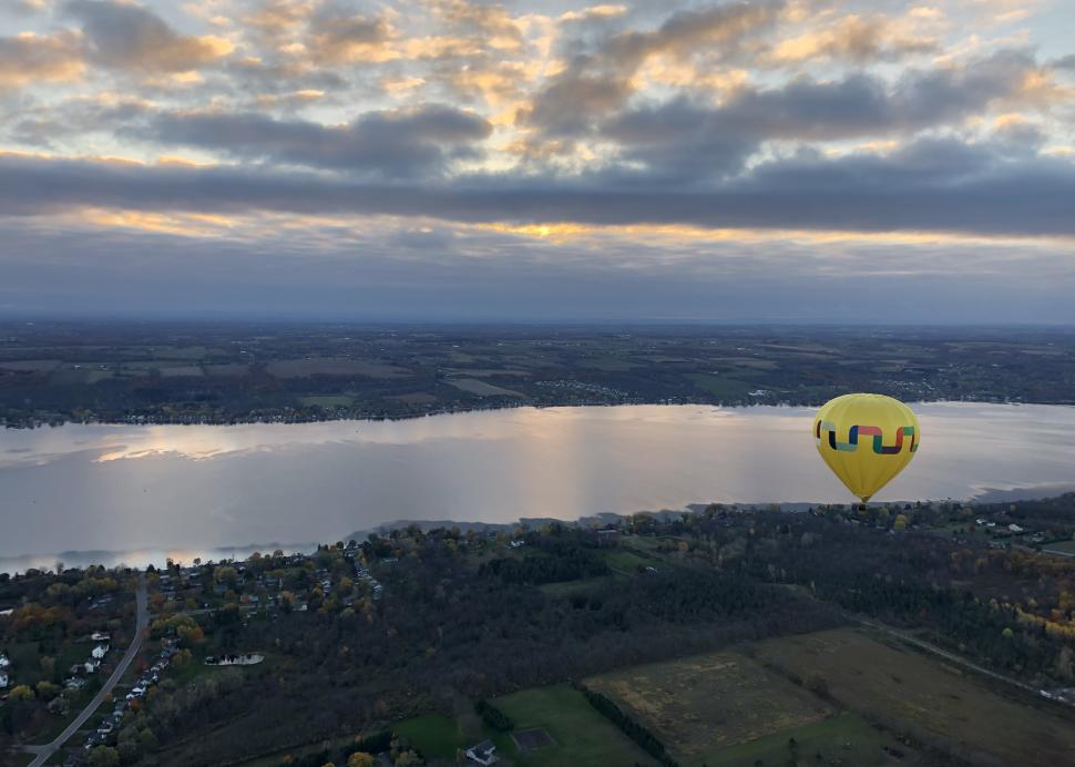 Scenic view of balloons over the lake