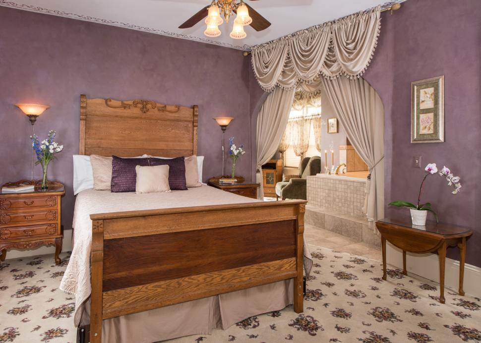 Photo of A Bed Inside The Burrell Suite At The Inn On The Main