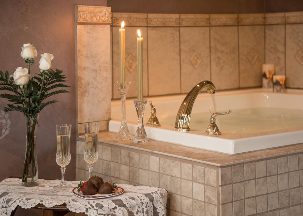 Inside Of A Luxurious Bathroom With A Candlelight Ambiance At The Inn On The Main