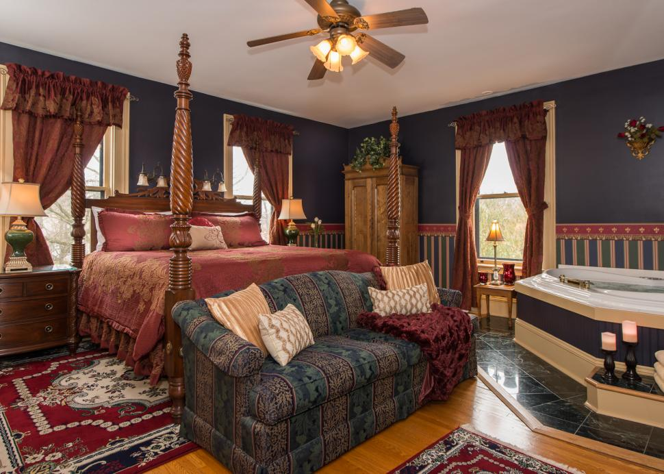 A Photo Of The Inside Of The Gifford Room with King Bed and Corner Jacuzzi