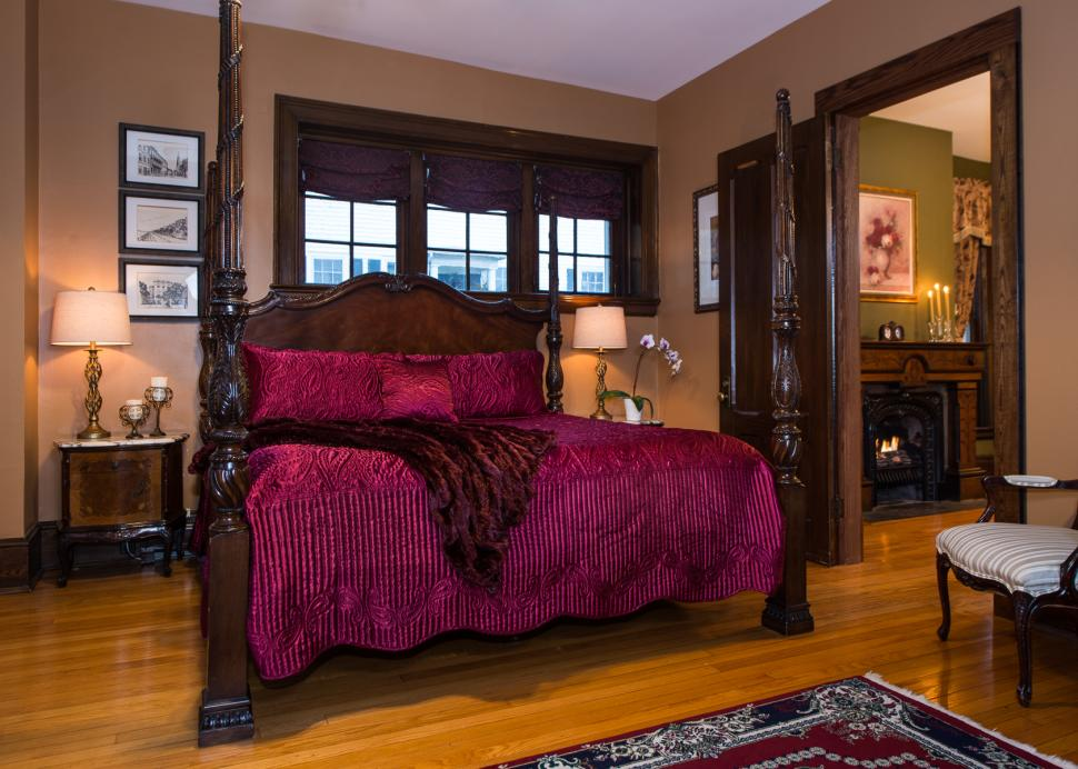 Photo of the bed inside the Penfield Suite at the Inn On The Main
