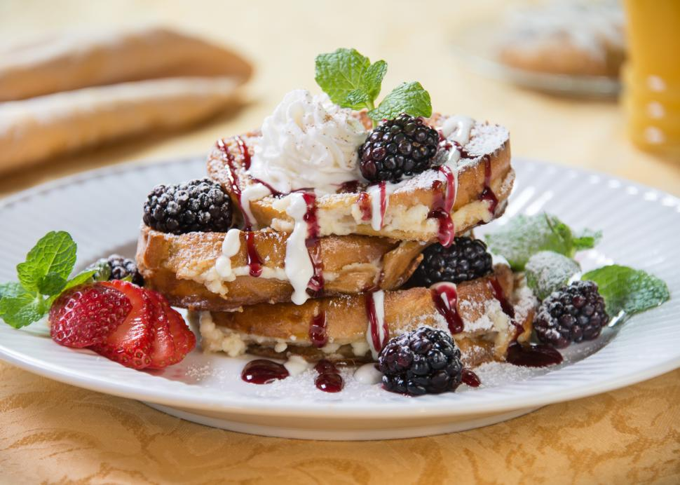 Breakfast Plate of Almond Stuffed Blackberry French Toast being served at The Inn On the Main