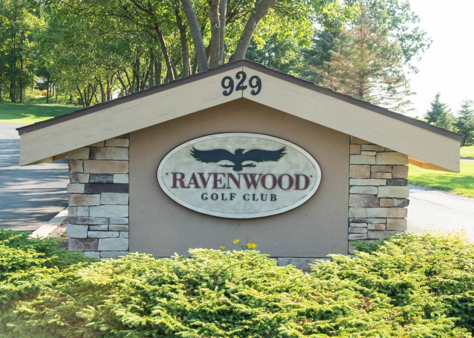 Exterior sign of Ravenwood Golf Course on a sunny day