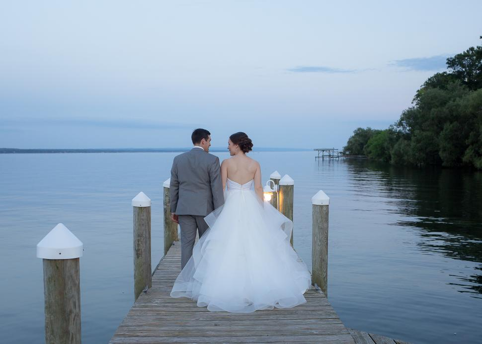 Couple on dock outside Belhurst after ceremony