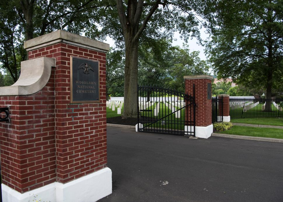 Exterior gates and inside gravestones at Woodlawn National Cemetery