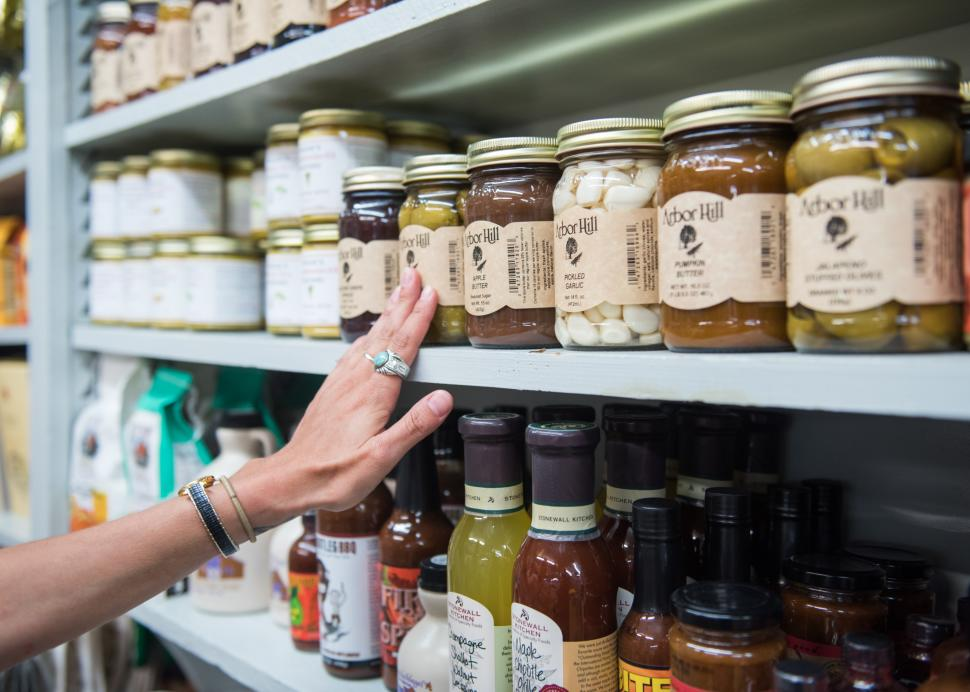 Photo of shopper looking at Arbor Hills selection of canned goods on a shelf