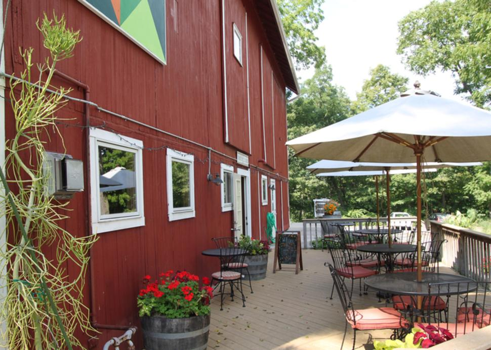 Photo of the tasting patio at Billsboro Winery during a sunny day
