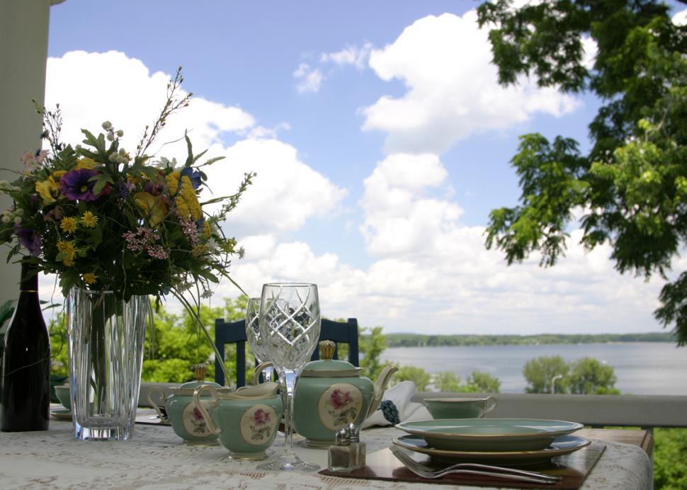 bragdon-house-geneva-exterior-dining-table-with-lake-in-view
