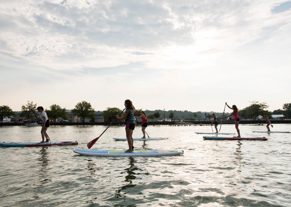 Customers participate in stand up Paddle boarding on Canandaigua Lake