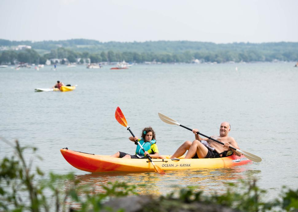 Photo of two kayakers enjoying a sunny day on Canandaigua Lake