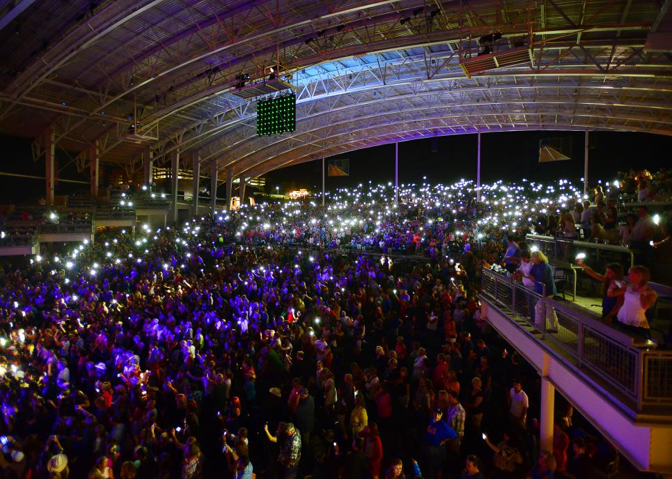 Photo of a crowd of people at a concert in the CMAC Center in Canandaigua