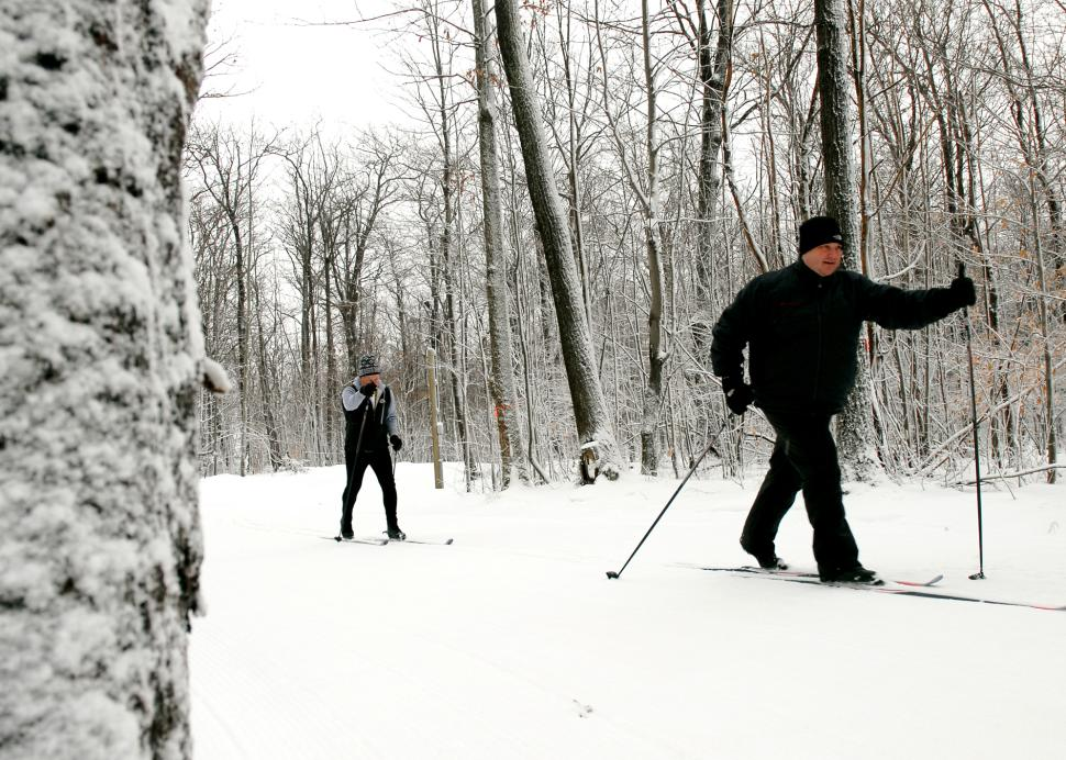 Two men enjoy a day of cross country skiing at Bristol Mountain