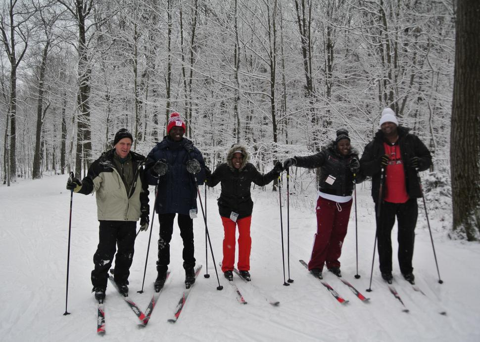 Group shot of nordic skiiers on the trail