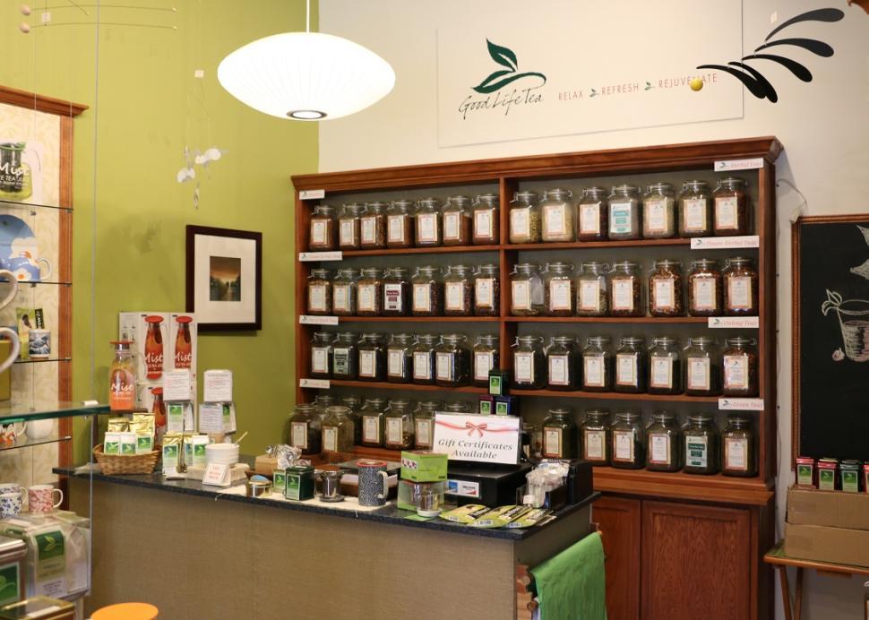 Photo of a shelf full of bottles of tea inside of Good Life Tea