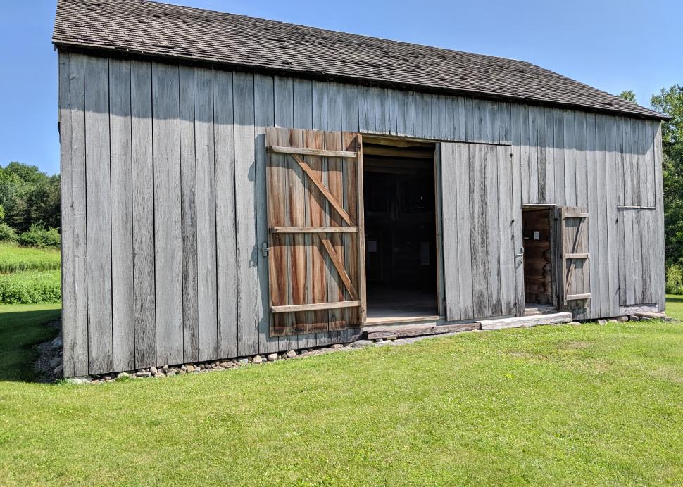 Photo of a barn at the welcome center for Hiram Edson Farm