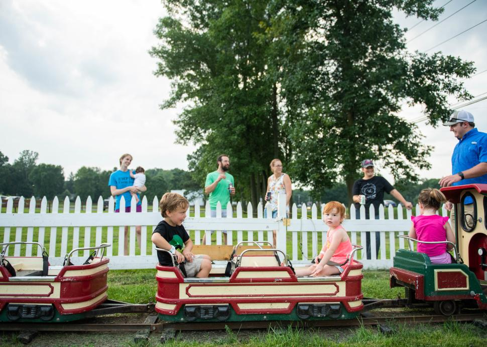 A kid enjoys a miniature train ride at the Pick n' Patch in Stanley