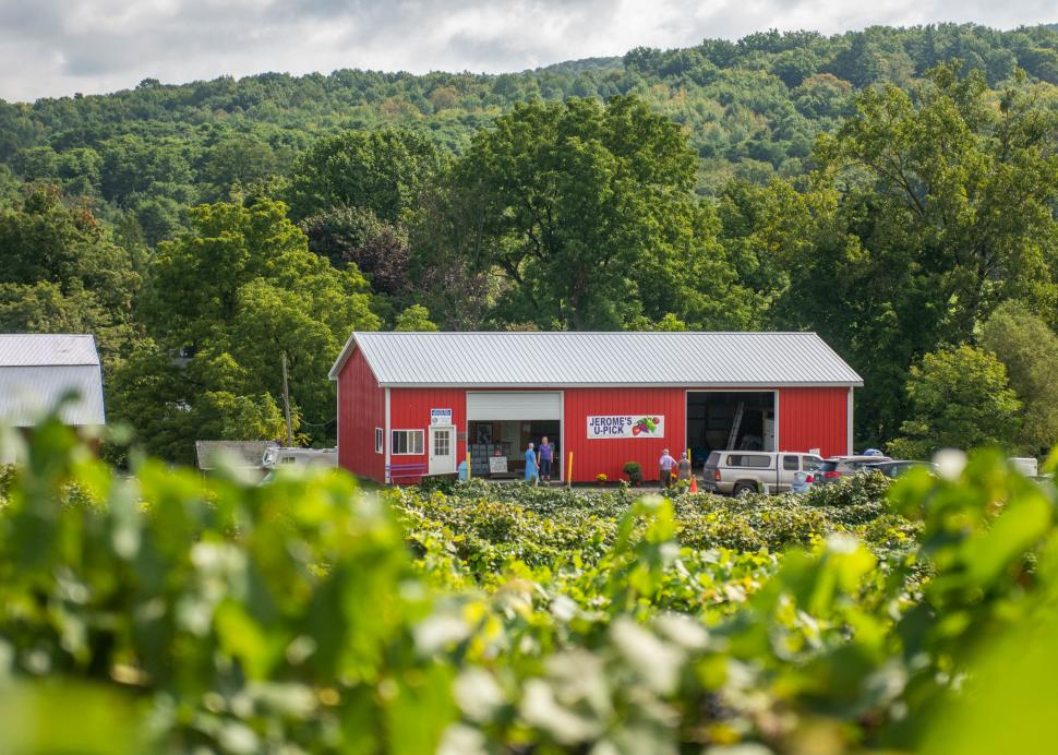 Exterior of a red barn that holds Jerome's U-Pick
